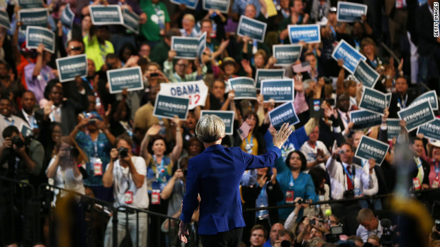 U.S. Senate candidate Elizabeth Warren of Massachusetts waves to the crowd Wednesday. A consumer advocate, she complained that people today &quot;feel like the system is rigged against them.&quot;