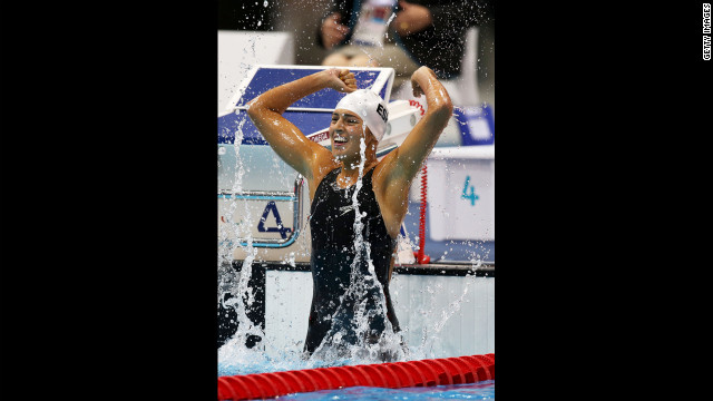 Michelle Alonso Morales of Spain celebrates after winning gold in the women's 100m breaststroke - SB14 final on Thursday.