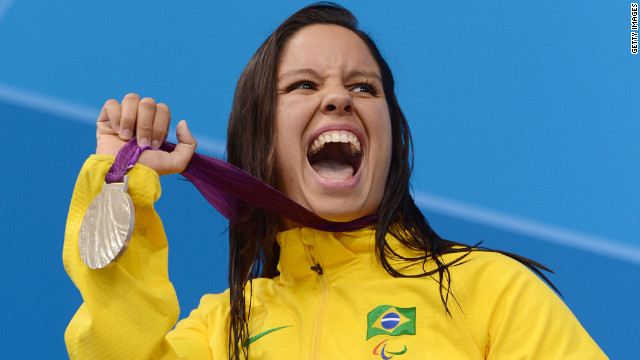 Silver medallist Edenia Garcia of Brazil poses on the podium during the medal ceremony for the women's 50m backstroke - S4 final on Thursday.