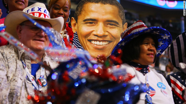 Delegates sit around a large cutout of President Obama's head during the final day of the convention on Thursday.