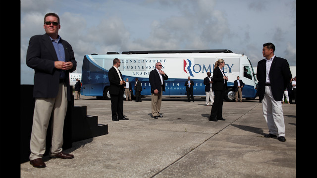Secret Service agents guard the campaign bus of Republican presidential candidate Mitt Romney during a Republican National Convention farewell rally on Friday, August 31, in Lakeland, Florida.