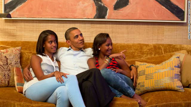 The president and daughters Malia, left, and Sasha, watch on television from Washington as Michelle Obama takes the stage to deliver her convention speech in Charlotte on Tuesday.