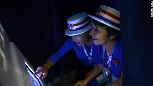 Priscilla Marquez and Evie Walls from Arizona pose in the Google photo booth at the Time Warner Cable Arena in Charlotte on Wednesday.