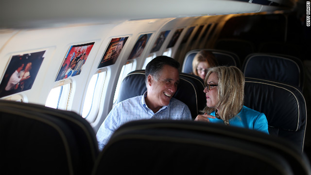 Mitt Romney and his wife, Ann Romney, talk on the campaign plane on Saturday, September 1, en route to their vacation home in New Hampshire.