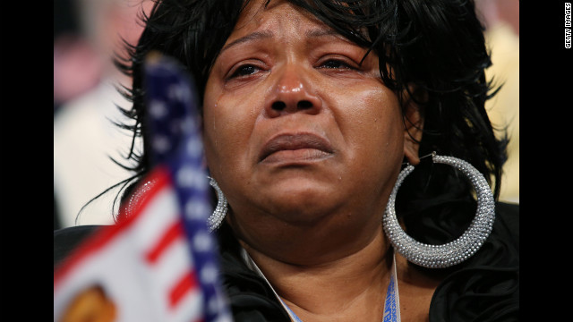 A woman cries as chairman of the Congressional Black Caucus, Missouri Rep. Emanuel Cleaver II, speaks during the DNC on Wednesday.