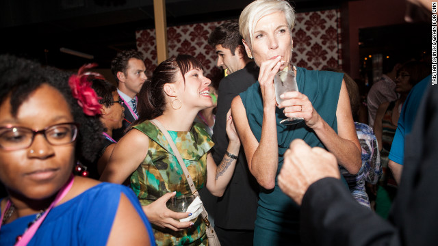 Planned Parenthood President Cecile Richards, right, sips her drink and socializes at Tuesday's event. She spoke at the Democratic National Convention the following night.