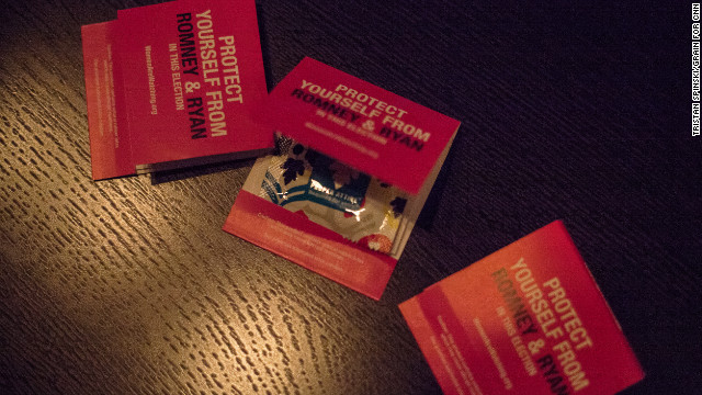 "Condoms in hot pink matchbook covers are distributed as party favors. They read: ""Protect yourself from Romney & Ryan in this election."""