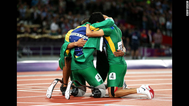 Members of the Brazilian team huddle after the men's 4x100-meter relay T42/T46 final on Thursday. 