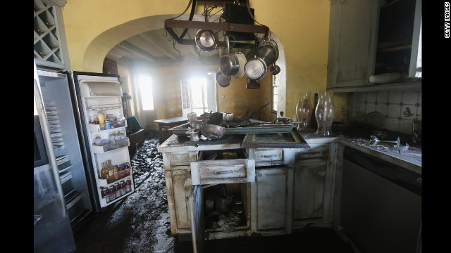 Mud coats the kitchen of the flooded Mary Plantation House, the oldest structure in Louisiana's Plaquemines Parish, on Thursday, September 6. At least 13,000 homes were damaged throughout Louisiana after Hurricane Isaac came ashore last week, a state official estimates.