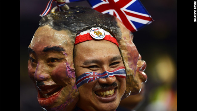 A spectator from Thailand wears masks as he watches Thursday's action at Olympic Stadium.
