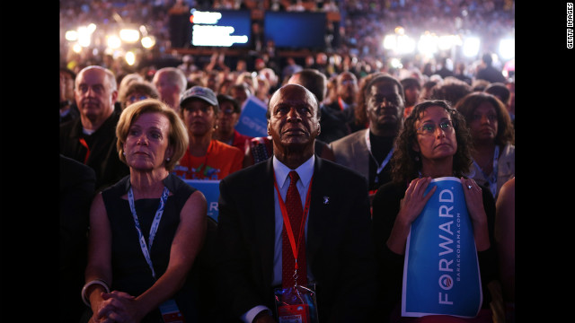 Attendees watch a video tribute for Barack Obama on Thursday.