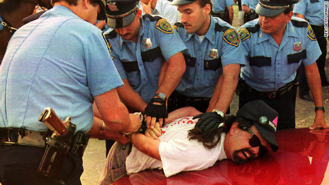 <strong>1992:</strong> Police officers at the 1992 Republican National Convention in Houston arrest a demonstrator from La Resistencia, an organization protesting acts of violence against immigrants and the deportation of illegal immigrants. The demonstrators failed to adhere to rules keeping them inside a 35-acre protest site across from the Astrodome, where convention delegates gathered.<br/><br/>