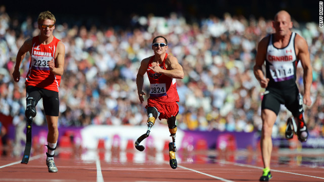 Rudy Garcia-Tolson, center, of the United States competes in the men's 100-meter T42 heats at the London 2012 Paralympic Gameson Friday.