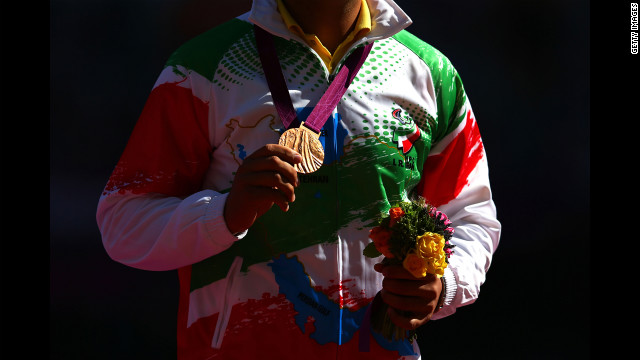 Bronze medalist Farzad Sepahvand of Iran poses Friday during the medal ceremony for the men's discus throw F44 final. 