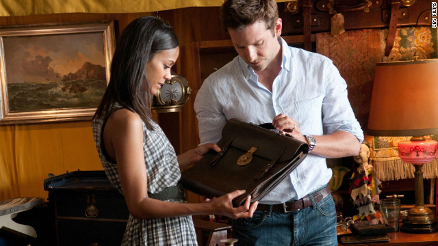 Zoe Saldana stars as Dora Jansen and Bradley Cooper as Rory Jansen in 
