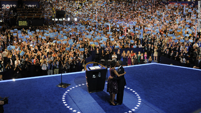 U.S. President Barack Obama kisses first lady Michelle Obama after giving his acceptance speech on Thursday.