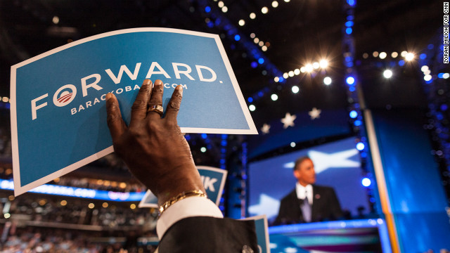 An attendee holds up a sign during Barack Obama's acceptance speech on Thursday.