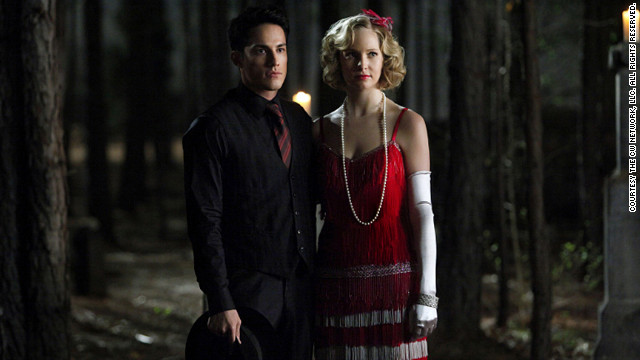 "For Mystic Falls High School's annual Decade Dances, Leverett said she dresses the human students like ""a teenager would interpret the period."" Though Tyler (Michael Trevino) and Caroline (Accola) are supernatural beings -- he's a hybrid vampire-werewolf and she's a vampire -- they're fairly new to being undead. They didn't live through the '20s like many of the other vampires in town. Leverett likes for the centuries-old vampires to attend such events in outfits they could have pulled from ""their vintage clothing storage closet."""