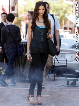 """Dobrev plays centuries-old vampire Katherine, pictured, as well as her human doppelganger Elena. Leverett makes it easy for viewers to differentiate between the characters by dressing Katherine in edgier styles. """"I like to think that Katherine saw those tan Michael Kors heels on some unsuspecting Chicago socialite and probably just compelled her to hand them over,"""" the costume designer said."""