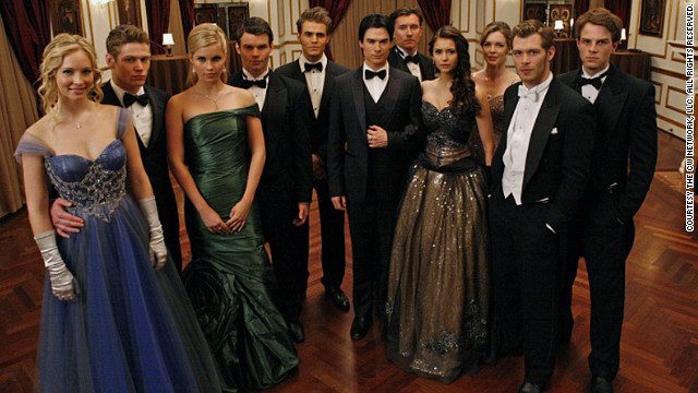 "The characters on ""The Vampire Diaries"" got all dolled up to attend a ball at vampire Klaus' (Joseph Morgan) house last season. <br/><br/>""We wanted it to have a Cinderella feel to it,"" costume designer Leigh Leverett said. Candice Accola's character Caroline, far left, donned an Alberto Makali dress, while Nina Dobrev's Elena, fourth from the right, wore a vintage black and gold ball gown. As for vampire Rebekah, played by Claire Holt, third from the left, ""This was the first dress she tried on. ... Rebekah has been around for 1,000 years ... her look is a little more sophisticated than our Mystic Falls girls."""
