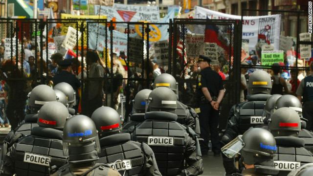 &lt;strong&gt;2004: &lt;/strong&gt;Riot police stand ready inside the gates of Boston's FleetCenter, site of the Democratic National Convention, as protesters march past. 
