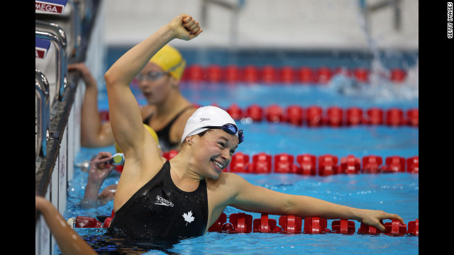 Valerie Grand-Maison of Canada celebrates after winning gold in the women's 200m individual medley - SM13 final on Friday.