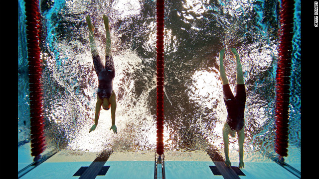 Sarah Rung, right, of Norway touches the wall ahead of Teresa Perales, left, of Spain to win gold in the women's 50m butterfly - S5 final on Friday.