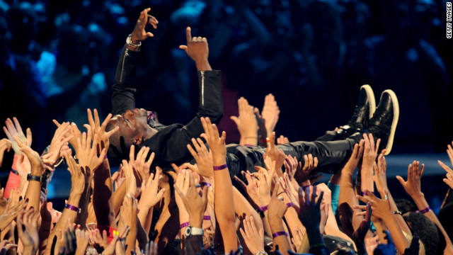 Comedian and host Kevin Hart surfs the crowd.