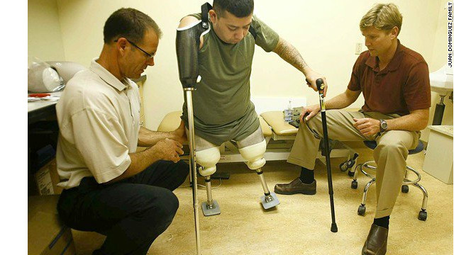 Dominguez undergoes physical therapy after the loss of three limbs in an explosion in Afghanistan.