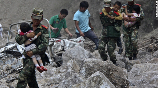 Soldiers carry children to safe ground after two earthquakes hit Zhaotong, Yunnan province, on Friday, September 7. Two shallow 5.6-magnitude quakes hit mountainous southwestern China, killing at least 80 people and forcing tens of thousands to leave damaged buildings, state media said.