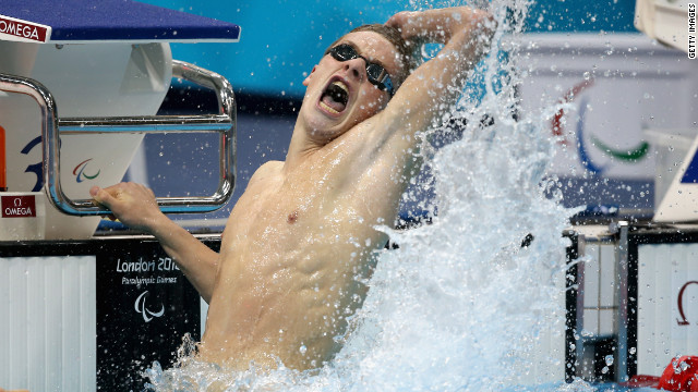Jack Bridge of Great Britain celebrates after his men's 100-meter breaststroke on Saturday.