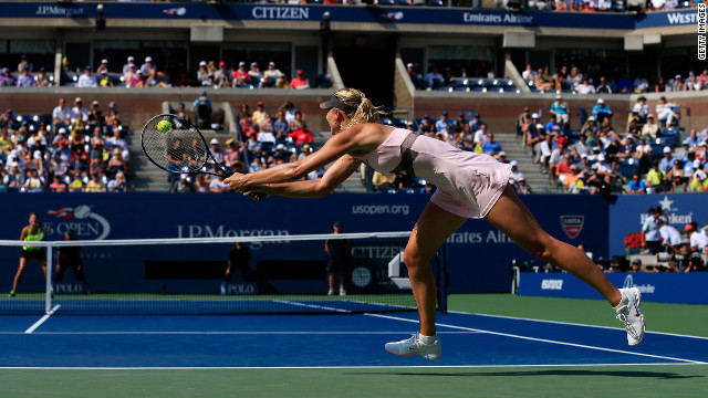 Sharapova returns a shot against Azarenka on Friday.