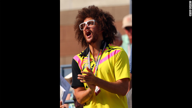 Stefan 'Redfoo' Gordy of the American electro duo LMFAO attends the women's singles semifinal match between Azarenka and Sharapova on Friday.