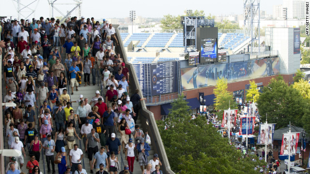 Spectators evacuate the Arthur Ashe Stadium during Ferrer and Djokovic's match as severe weather approached on Saturday. 
