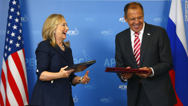 Hillary Clinton and Sergei Lavrov exchange documents after signing a memorandum of understanding on Antarctica.