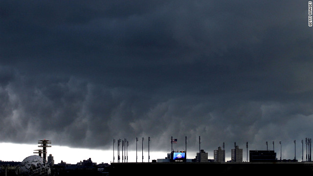 A storm front passes behind the USTA Billie Jean King National Tennis Center. Scheduled matches were suspended at the U.S. Open tennis tournament in Queens after two tornadoes touched down nearby.