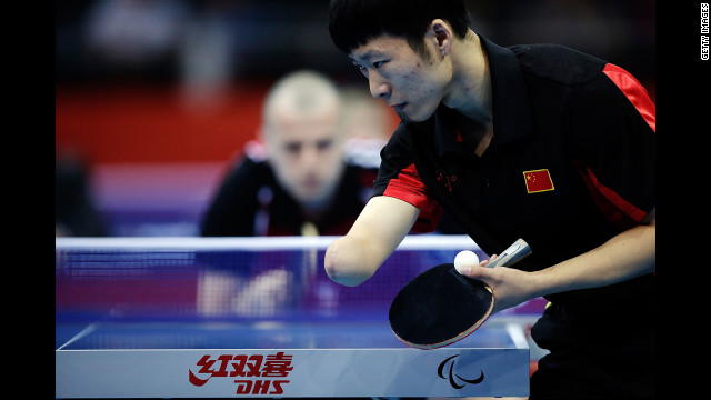 China's Yang Ge serves against Poland's Sebastian Powrozniak during the men's team table tennis Class 9-10 final on Saturday.