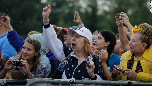 People cheer as Mitt Romney arrives for a campaign stop at Mapleside Farms on June 17, 2012 in Brunswick, Ohio.