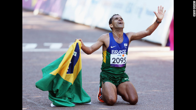 Tito Sena of Brazil celebrates winning the men's T46 marathon on Sunday, September 9, the final day of the London 2012 Paralympics.