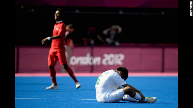 Mateus Francisco Tostes Calvo of Brazil, in white, sits on the field after losing to Iran 5-0 in the men's team football 7-a-side bronze medal match Sunday.