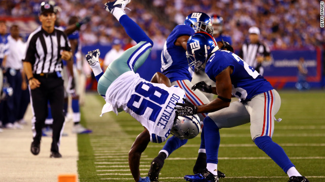 No. 85 Kevin Ogletree of the Dallas Cowboys dives into the end zone to score during the Cowboys' 24-17 win over the New York Giants on Wednesday.