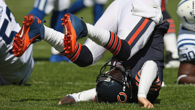 No. 6 Jay Cutler of the Bears ends up on his back after being hit while passing against the Colts in Chicago on Sunday.