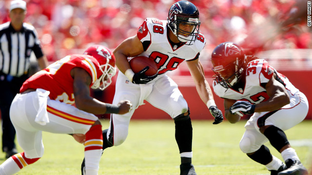Tight end No. 88 Tony Gonzalez of the Falcons carries the ball after making a catch as strong safety No. 29 Eric Berry of the Chiefs defends on Sunday in Kansas City, Missouri.