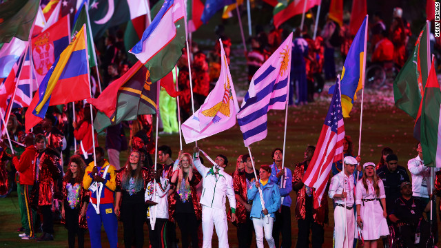 Flag bearers carry their national flags during the closing ceremony.