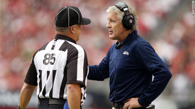 Head coach Pete Carroll of the Seahawks talks with side judge Mike Riley on Sunday.