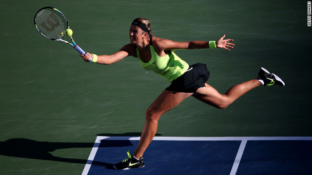 Azarenka returns a shot against Williams.
