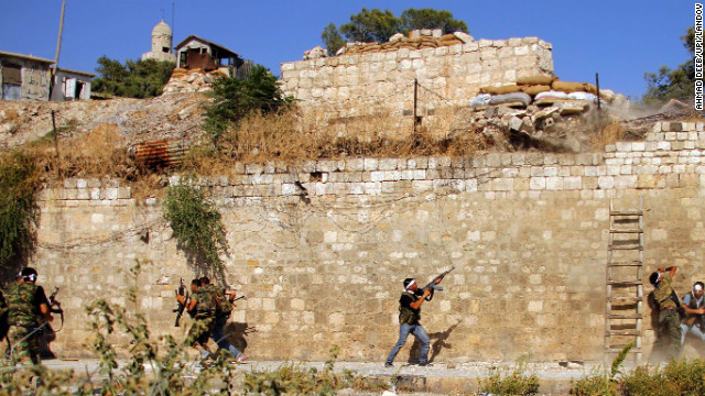 Free Syrian Army fighters battle during street fighting against Syrian army soldiers in Aleppo on September 8.
