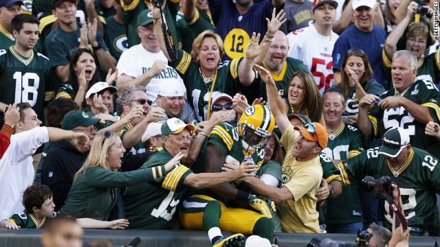 No. 89 James Jones of the Green Bay Packers celebrates with fans after catching a 10-yard touchdown pass in the fourth quarter of the game against the San Francisco 49ers on Sunday.