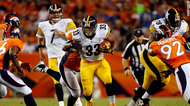 No. 33 running back Isaac Redman of the Pittsburgh Steelers rushes with the ball as No. 96 defensive end Mitch Unrein of the Denver Broncos makes the tackle on Sunday.