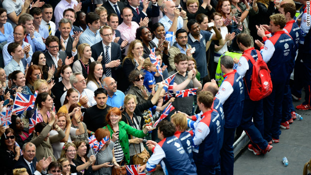 Members of Team GB greet spectators as the Victory Parade passes along Fleet Street, London. 